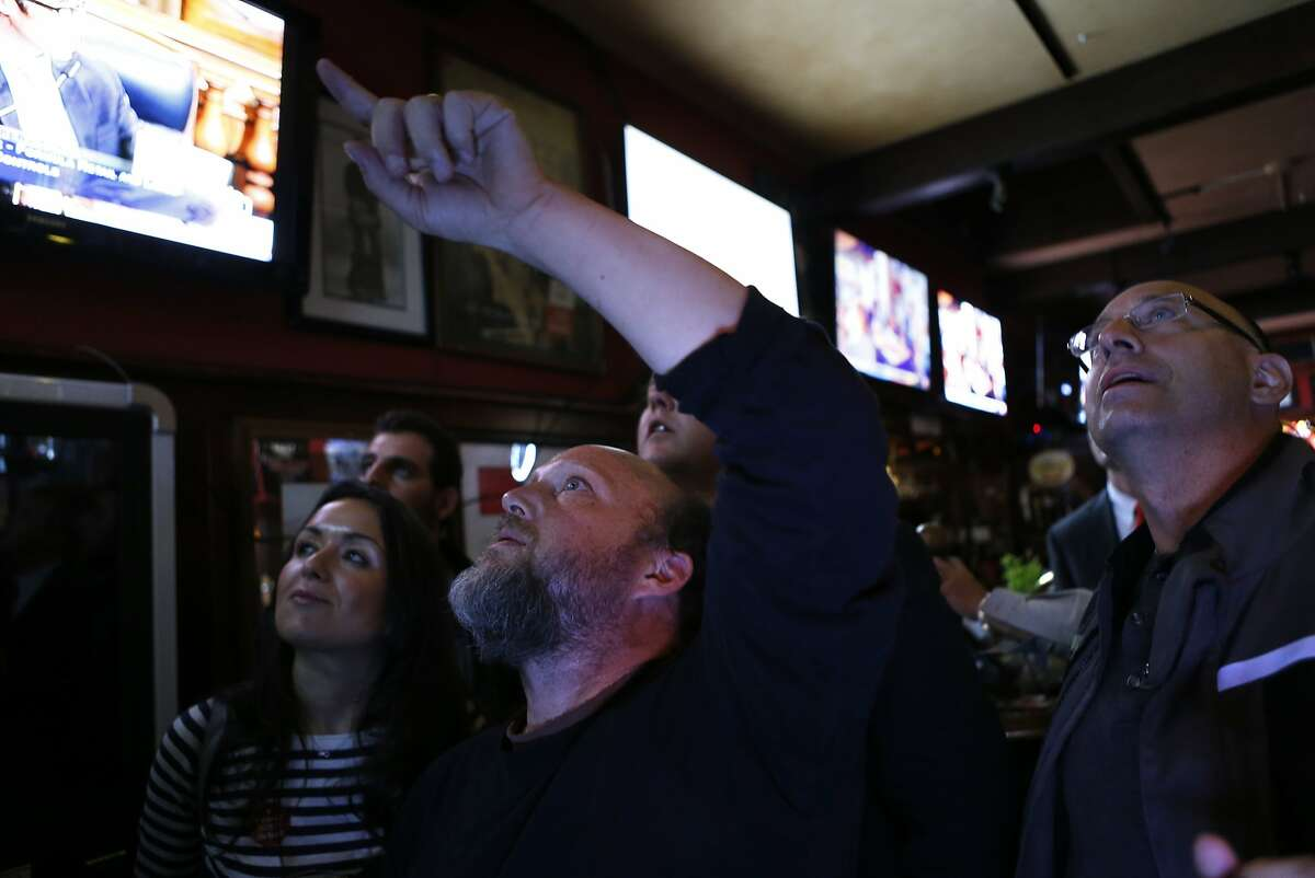 Proposition E campaign manager Todd David (center) watches voting results at Valley Tavern on 24th Street in San Francisco, Calif., on Tuesday, November 4, 2014.