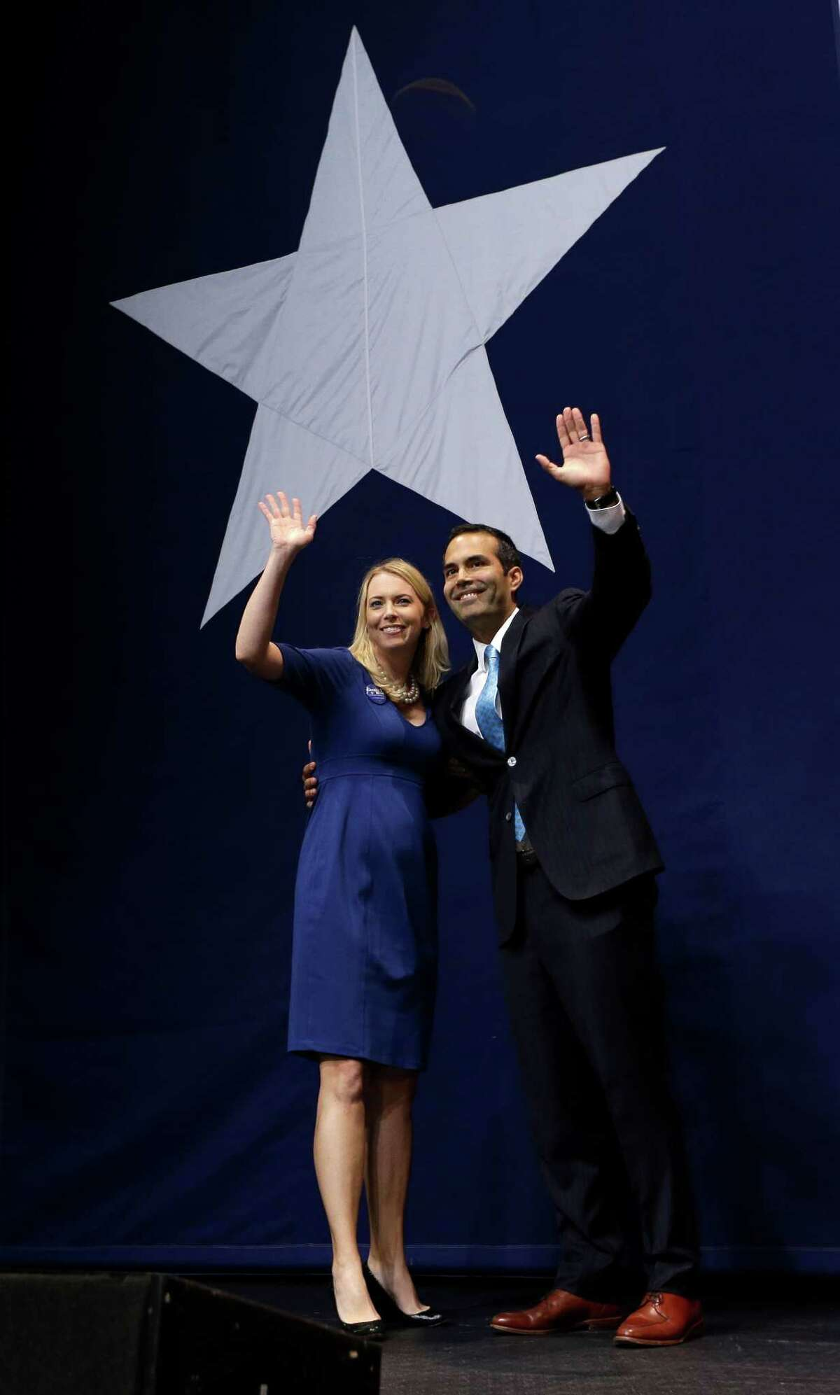 George P. Bush and his wife, Amanda, acknowledge the crowd after his victory speech in Austin following his win in the race for Texas land commissioner on Tuesday.
