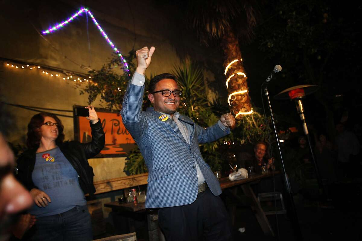 David Campos chants 'Si se puede!' with the crowd at his election night party at El Rio in San Francisco, Calif., on Tuesday, November 4, 2014.