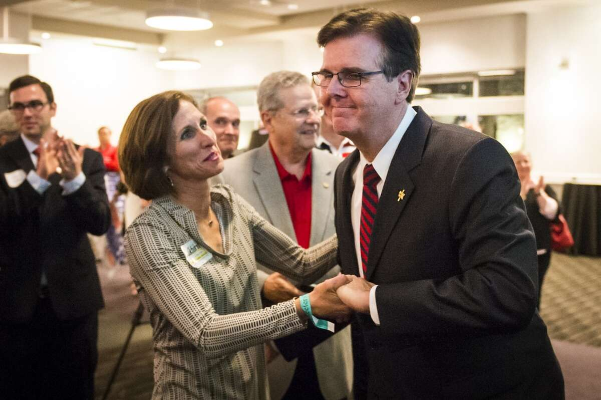 Sen. Lois Kolkhorst congratulates Lt. Gov.-elect Dan Patrick as he takes the stage during an election night watch party in Houston.