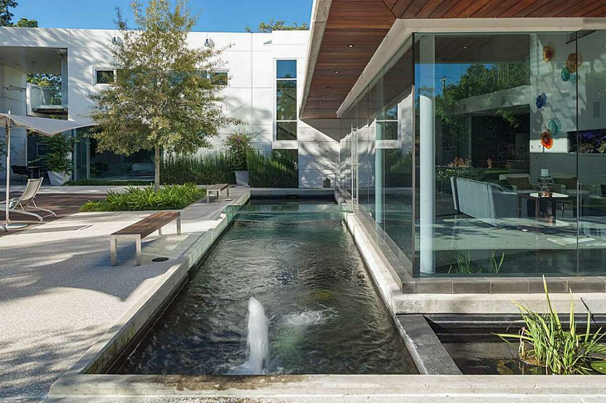 8730 Memorial: This award-winning home features 4-5 bedrooms, 5 full and 2 half baths, a pool, large glass walls and windows and is on the market for $4.9 million.