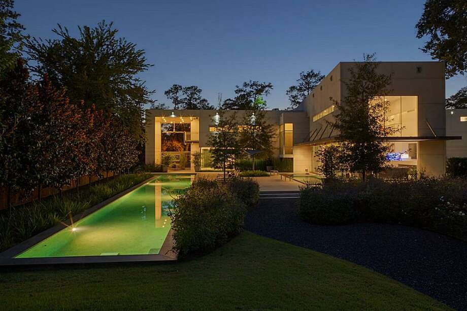 8730 Memorial: This award-winning home features 4-5 bedrooms, 5 full and 2 half baths, a pool, large glass walls and windows and is on the market for $4.9 million. Photo: Courtesy Of Houston Association Of Realtors