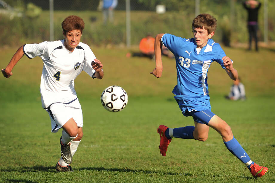 Notre Dame's Felipe Canzian, battles a Bunnell player for possession of the ball in a game earlier this season. Canzian, a freshman, was named to the first-team All-SWC boys' soccer team as the Lancers made the CIAC tournament for the first time since 1993.     left, and Bunnell's Thomas Durivage play the ball during their boys soccer matchup at Notre Dame High School in Fairfield, Conn. on Monday, October 6, 2014. Photo: Brian A. Pounds / Connecticut Post