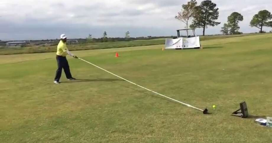 A Texas man has set a new Guinness World Record for longest shot accomplished with the longest usable golf club at a country club in Arlington on Nov. 3, 2014.  A YouTube video shows Dallas man Michael Furrh hitting a ball 63 yards with a driver measuring 20 feet, six inches long. Photo: Fechter, Joshua I, YouTube