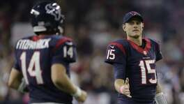 Houston Texans backup quarterback Ryan Mallett (15) congratulates quarterback Ryan Fitzpatrick (14) as he comes off the field during the second quarter of an NFL football game, Thursday, Oct. 9, 2014, in Houston. (AP Photo/Patric Schneider)