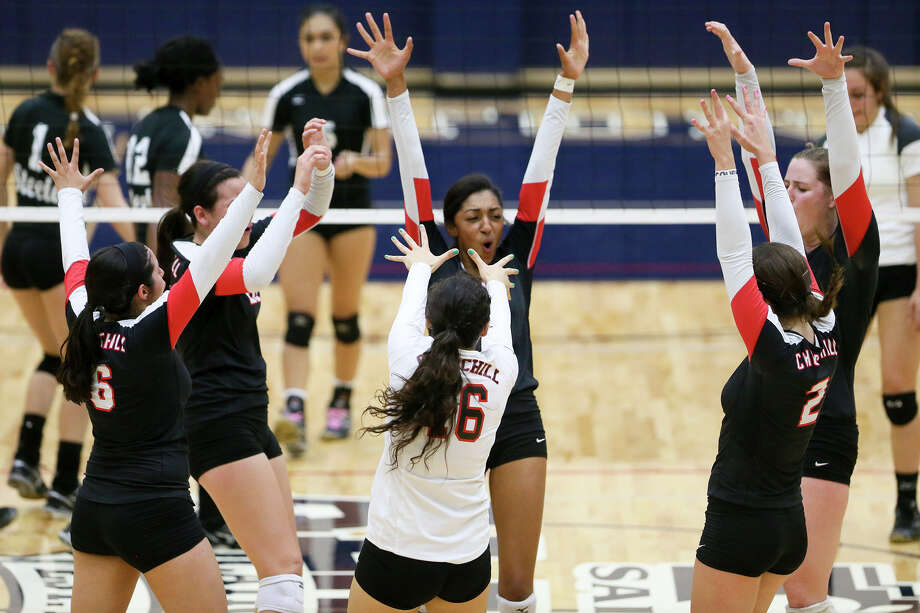 The Churchill Lady Chargers celebrate a point during their UIL Class 6A first-round volleyball playoff match with Steele at Alamo Convocation Center on Tuesday, Nov. 4, 2014.  Churchill beat the Lady Knights in four sets: 25-18-, 21-25, 25-18 and 25-16.  MARVIN PFEIFFER/ mpfeiffer@express-news.net Photo: MARVIN PFEIFFER, STAFF / Marvin Pfeiffer/ Express-News / Express-News 2014