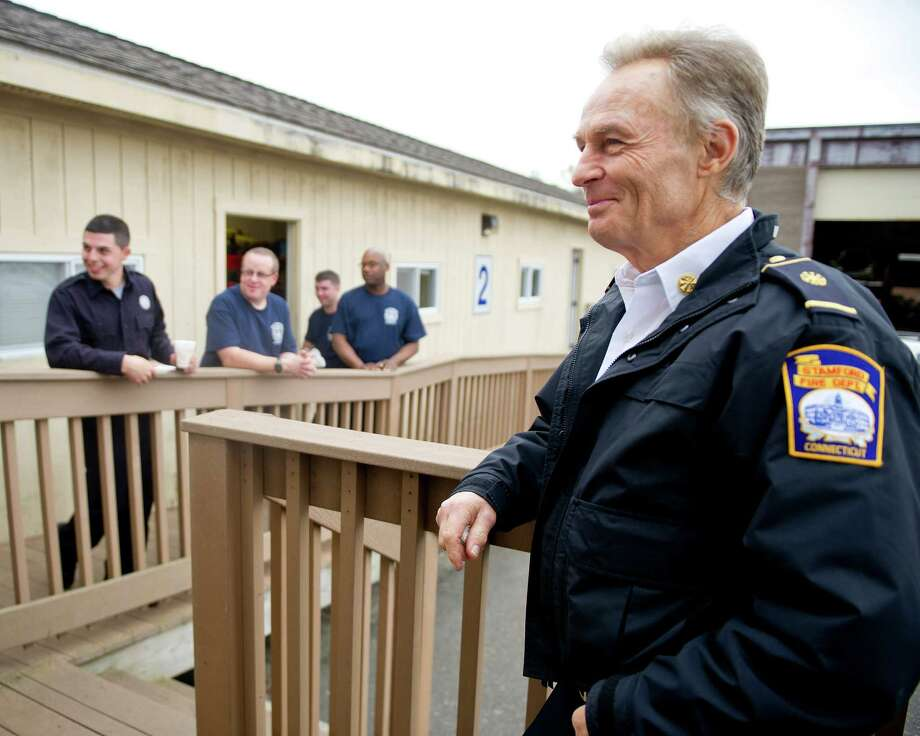 Robert Morris, new Fire Department Chief of Volunteer Services, talks with graduating firefighters at the drill field in Stamford, Conn., on Wednesday, November 5, 2014. Photo: Lindsay Perry / Stamford Advocate