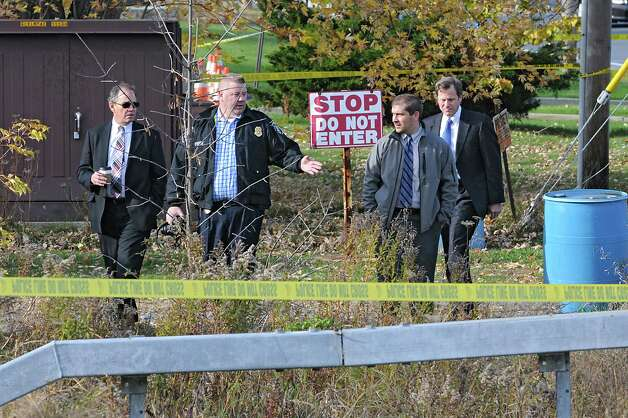Police investigate an area where a badly decomposed body was found near a bridge by 33 Freemans Bridge Rd. on Wednesday, Nov. 5, 2014 in Glenville, N.Y. (Lori Van Buren / Times Union) Photo: Lori Van Buren / 00029373A