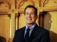 Gov. Dannel P. Malloy Wednesday, Nov. 5, 2014, during a news conference at the State Capitol in Hartford, Conn.