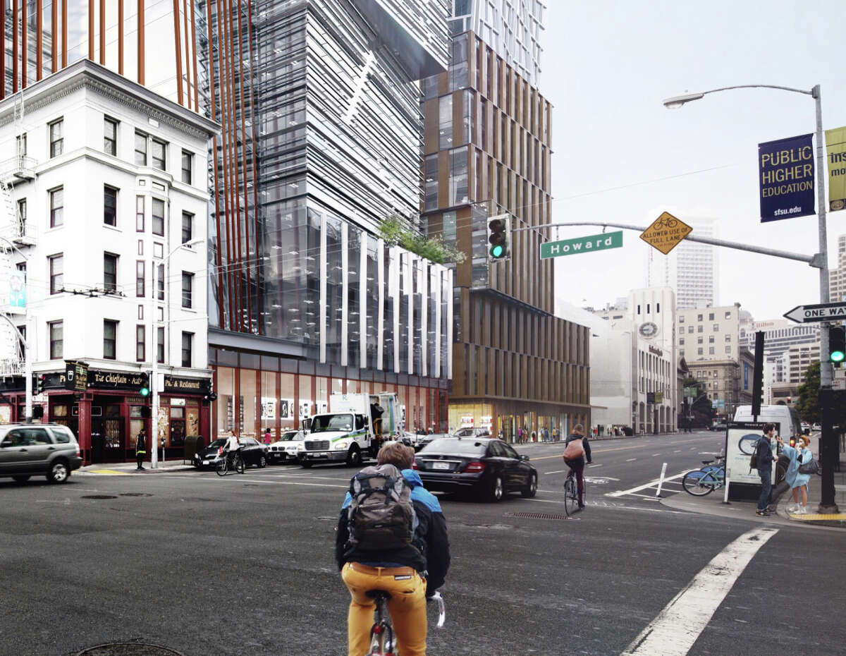 The proposed 5M complex would include two high-rise towers on the west side of Fifth Street, including an office building with vertical white-metal fins.