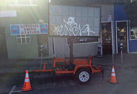 A traffic sign on an orange trailer was parked in the same spot on Geary Boulevard for at least two months, annoying business owners and residents.