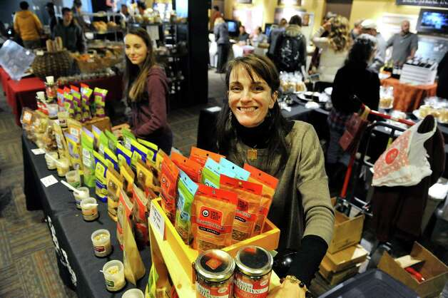 Caroline Barrett, foreground, and her daughter Zoe, 13, at the Our Daily Eats booth at the Schenectady Greenmarket on Sunday, Nov. 2, 2014, in Schenectady, N.Y.  Caroline Barrett started the local food company ten years ago, starting with just one product and now she sells 17 products.  (Paul Buckowski / Times Union) Photo: Paul Buckowski / 00029291A