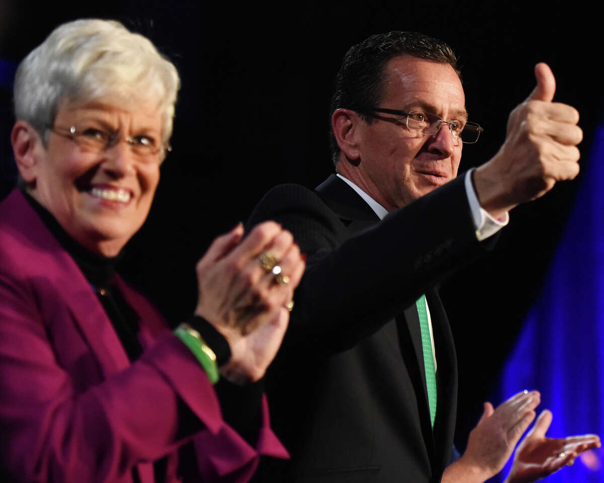 Connecticut Gov. Dannel P. Malloy gives a thumbs up beside Lt. Gov. Nancy Wyman before delcaring victory in the 2014 gubernatorial election at the Society Room in downtown Hartford, Conn. Tuesday, Nov. 4, 2014. The incumbent Democrat governor retained office, defeating Greenwich Republican Tom Foley by a narrow margin in the 2014 gubernatorial election.