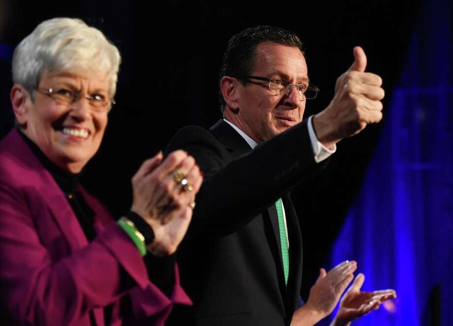 Connecticut Gov. Dannel P. Malloy gives a thumbs up beside Lt. Gov. Nancy Wyman before delcaring victory in the 2014 gubernatorial election at the Society Room in downtown Hartford, Conn. Tuesday, Nov. 4, 2014.  The incumbent Democrat governor retained office, defeating Greenwich Republican Tom Foley by a narrow margin in the 2014 gubernatorial election. Photo: Tyler Sizemore / Greenwich Time