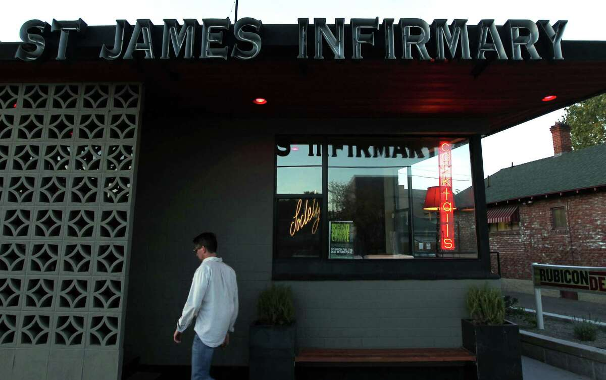 Visitors to the St. James Infirmary bar in Reno's Midtown area can kick back in classic white leather booths lined with old movie photo collages.