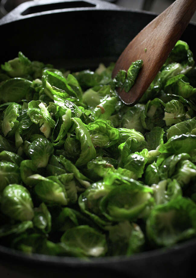 Molly Watson's Brussels sprouts cook on the stove. Photo: Liz Hafalia / The Chronicle / ONLINE_YES