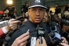 FILE - In this April 1, 2013, file photo, reporters surround New York Yankees' Alex Rodriguez who held an impromptu press conference outside the clubhouse door before the Yankees Opening Day baseball game at Yankee Stadium in New York. A lawyer for the University of Miami's former pitching coach says Alex Rodriguez admitted to federal investigators he used steroids. Attorney Frank Quintero Jr., who represents Lazaro Collazo in his defense of charges of conspiracy to distribute performance-enhancing drugs, told The Associated Press that the New York Yankees third baseman confessed to steroids use, according to Drug Enforcement Administration documents provided by the government to lawyers in the case. The Miami Herald first reported Rodriguez's confession Wednesday,Nov. 5, 2014. (AP Photo/Kathy Willens, File)