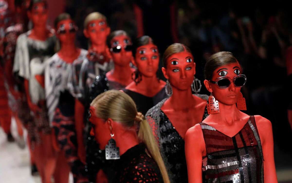 Models wear creations from the Ronaldo Fraga Winter collection during the Sao Paulo Fashion Week in Sao Paulo, Brazil, Wednesday, Nov. 5, 2014.