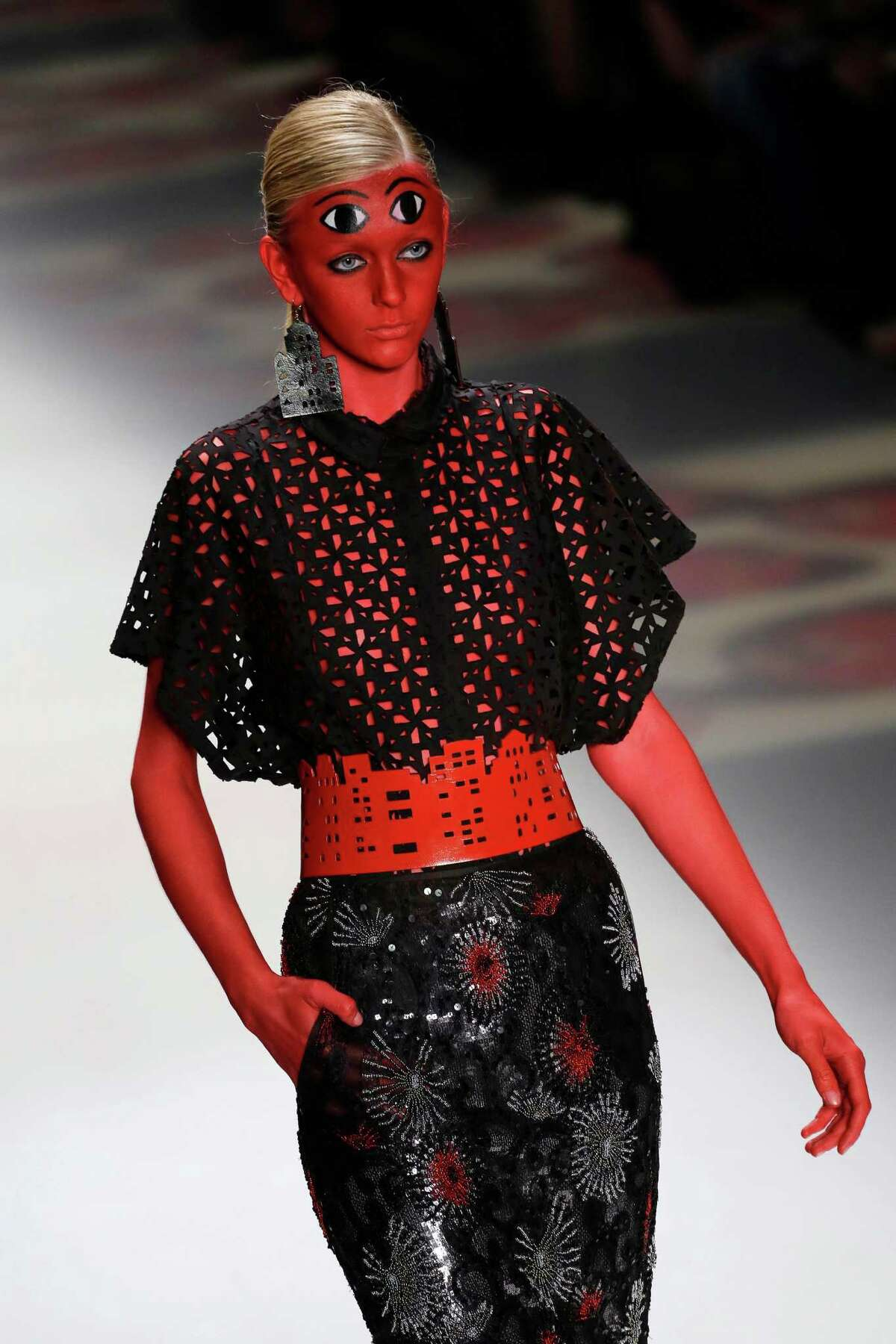A model wears a creation from the Ronaldo Fraga Winter collection during the Sao Paulo Fashion Week in Sao Paulo, Brazil, Wednesday, Nov. 5, 2014.