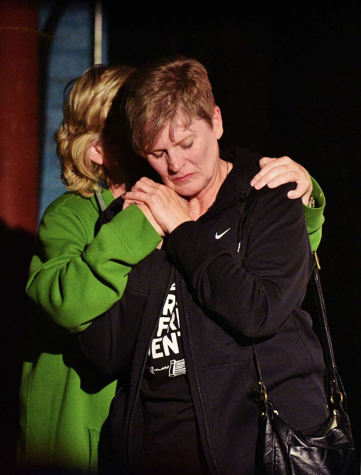 """Cathy McMullen, president of the Denton Drilling Awareness Group hugs Sharon Wilson, an organizer with the group Earthworks, on stage at an election watch party at Dan's Silverleaf to see the results of propositions to ban hydraulic fracturing within the City of Denton and to remove the private club rules for alcohol sales and make Denton an officially """"wet"""" city, Tuesday, Nov. 4, 2014, in Denton, Texas. (AP Photo/Denton Record-Chronicle, David Minton)"""