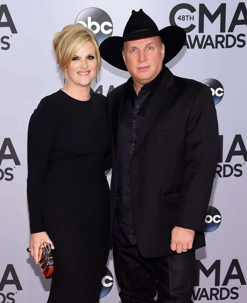 NASHVILLE, TN - NOVEMBER 05: Trisha Yearwood and Garth Brooks attend the 48th annual CMA Awards at the Bridgestone Arena on November 5, 2014 in Nashville, Tennessee.