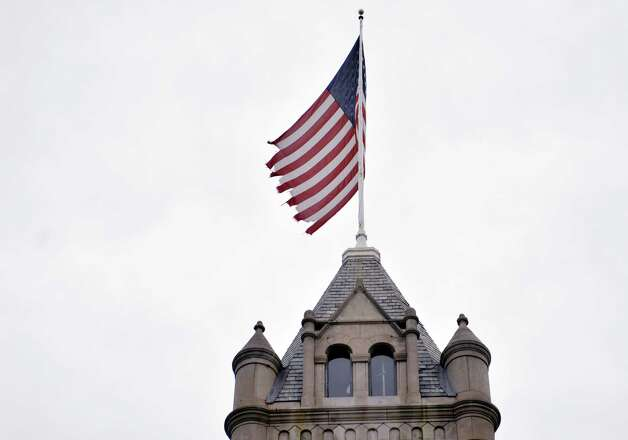The old flag before it was replaced is seen flying on top of the Cohoes City Hall building on Wednesday, Nov. 5, 2014, in Cohoes, N.Y.  (Paul Buckowski / Times Union) Photo: Paul Buckowski / 00029338A