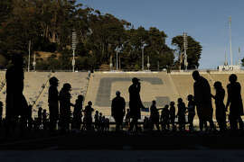 The Cal football team practices Wednesday at Memorial Stadium. UC Berkeley is cutting back on recruiting athletes that fall short of its usual academic standards after receiving criticism for low graduation rates among football and basketball players.