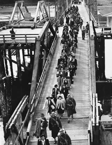 Japanese Americans wait at a Bainbridge Island pier for a ferry to Seattle, during their forced removal from home on March 30, 1942, after President Franklin Roosevelt signed Executive Order 9066. Photo: AP / 1941 AP