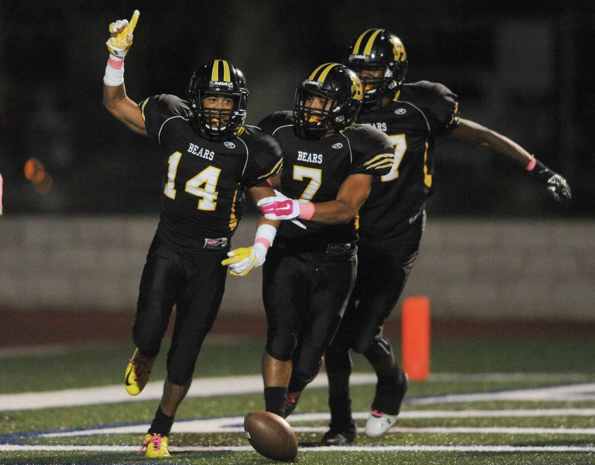 Brennan defender Derrick Hill (14) celebrates after scoring on an intercepted pass against Jay during the first half of a District 27-6A Zone A game at Farris Stadium on Oct. 23, 2014.