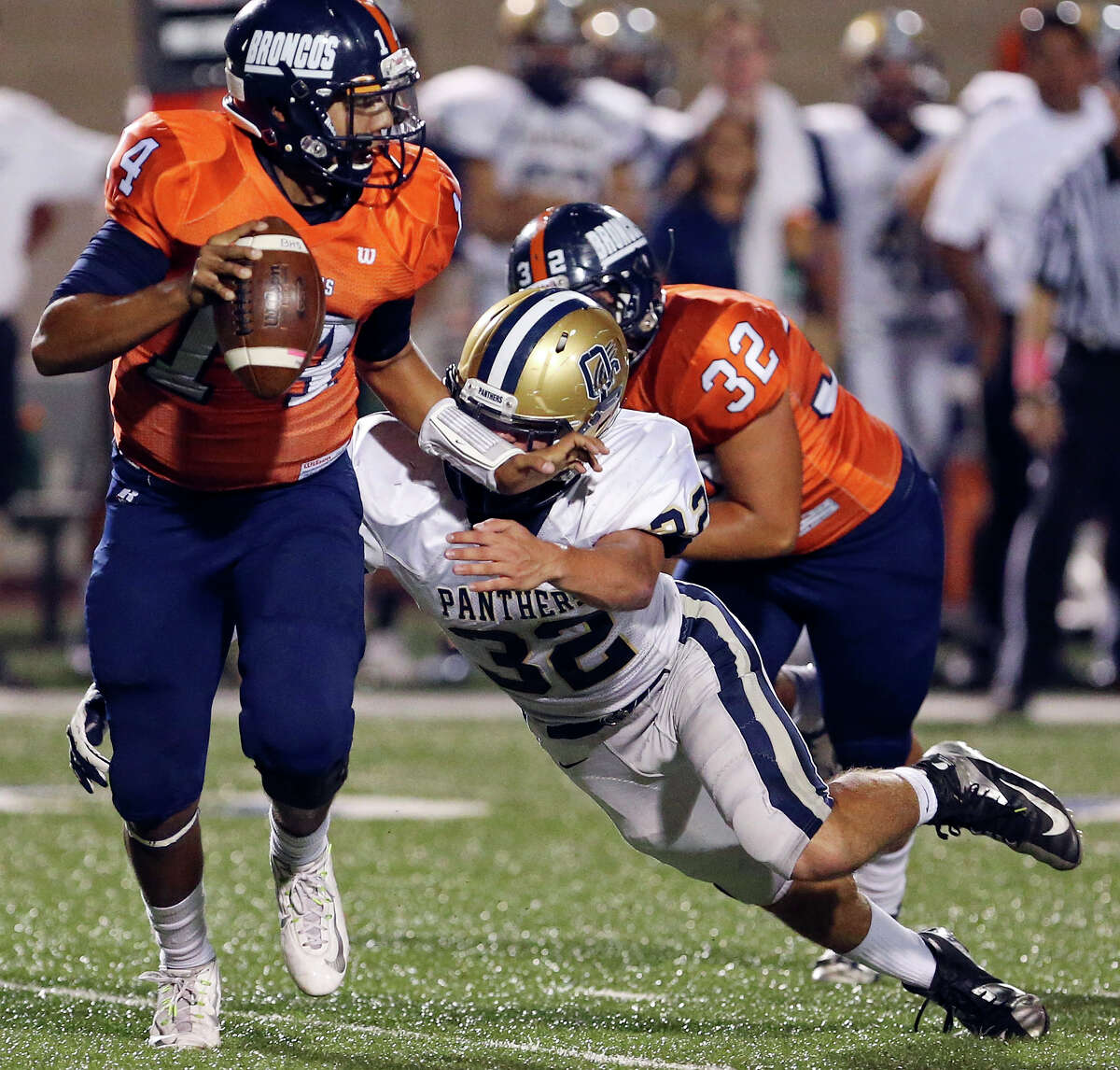 Brandeis' Paul Lozano looks for running room around O'Connor's Darren Jasso during first half action Friday Oct. 24, 2014 at Farris Stadium. Lozano was sacked on the play.