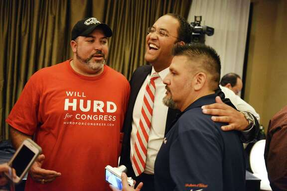 Republican congressional candidate Will Hurd, center, greets his brother, Charlie, left, during an election night watch party. Hurd carried the San Antonio area to capture U.S. House District 23 from Democrat Pete Gallego.