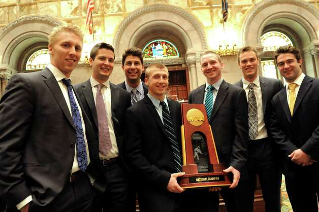 Union hockey players pose with their NCAA Championship trophy in the Senate Chambers on Wednesday, May 7, 2014, at the Capitol in Albany, N.Y. From left, are Mark Bennett, Dillon Pieri, Alex Sakellaropoulos, Matt Wilkins, Matt Krug, Charlie Vasaturo, and Sam Coatta. (Cindy Schultz / Times Union) Photo: Cindy Schultz / 00026789A