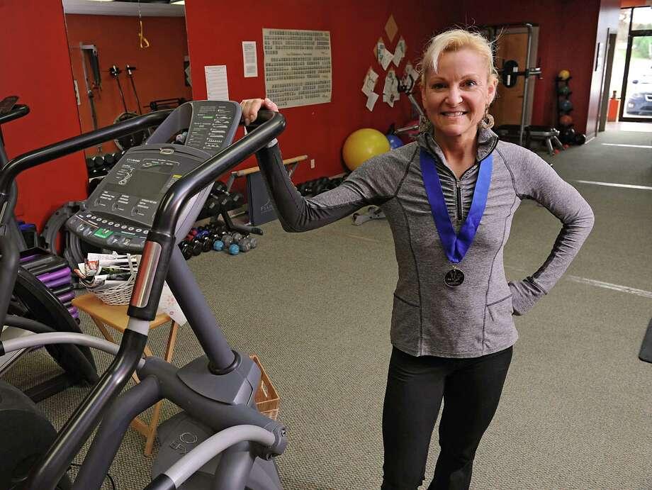 Personal trainer and Ironman coach Judy Torel stands in her fitness studio on Wednesday, Nov. 5, 2014 in Albany, N.Y. (Lori Van Buren / Times Union) Photo: Lori Van Buren / 00029363A