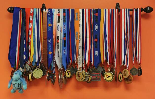 Medals earned by personal trainer and Ironman coach Judy Torel are seen in the office of her fitness studio on Wednesday, Nov. 5, 2014 in Albany, N.Y. (Lori Van Buren / Times Union) Photo: Lori Van Buren / 00029363A