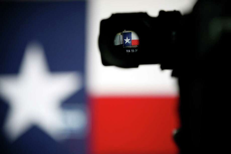 The podium with a Wendy Davis sign on the stage is seen through the lens of a television camera at Texas Democratic gubernatorial candidate Wendy Davis' campaign watch party, Tuesday, Nov. 4, 2014, in Fort Worth, Texas. (AP Photo/Tony Gutierrez) Photo: Tony Gutierrez, Associated Press / AP