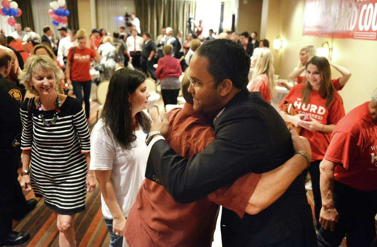 Republican Will Hurd gets a hug from supporter Mike Penrod at Eilan Hotel Resort and Spa after deciding to call it a night Tuesday with the results of his race unclear. Incumbent Rep. Pete Gallego called to congratulate Hurd around 1 a.m. Wednesday.