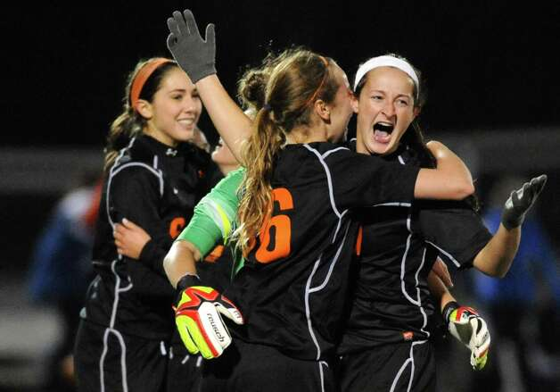 Bethlehem's Kaylee Rickert, right, celebrates with teammates after they defeated Saratoga Springs 2-1 in the girls high school soccer Section II Class AA final at Stillwater High School on Wednesday Nov. 5, 2014 in Stillwater, N.Y. Rickert scored the winning goal. (Michael P. Farrell/Times Union) Photo: Michael P. Farrell / 00029336A