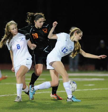 Bethlehem's Callie Noonan, center, battles Saratoga's Cassidy Henderson, left, and Theresa Starnes for the ball as Bethlehem defeated Saratoga Springs 2-1 in the girls high school soccer Section II Class AA final at Stillwater High School on Wednesday Nov. 5, 2014 in Stillwater, N.Y. (Michael P. Farrell/Times Union) Photo: Michael P. Farrell / 00029336A