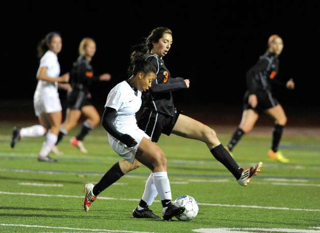 Bethlehem's Holly Moore and Saratoga's Ya'nique Van Ness battle for the ball as Bethlehem defeated Saratoga Springs 2-1 in the girls high school soccer Section II Class AA final at Stillwater High School on Wednesday Nov. 5, 2014 in Stillwater, N.Y. (Michael P. Farrell/Times Union) Photo: Michael P. Farrell / 00029336A