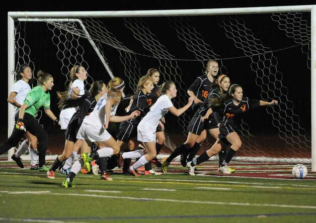 Bethlehem's defence swarms the front of their goal to halt a Saratoga threat as Bethlehem defeated Saratoga Springs 2-1 in the girls high school soccer Section II Class AA final at Stillwater High School on Wednesday Nov. 5, 2014 in Stillwater, N.Y. (Michael P. Farrell/Times Union) Photo: Michael P. Farrell / 00029336A