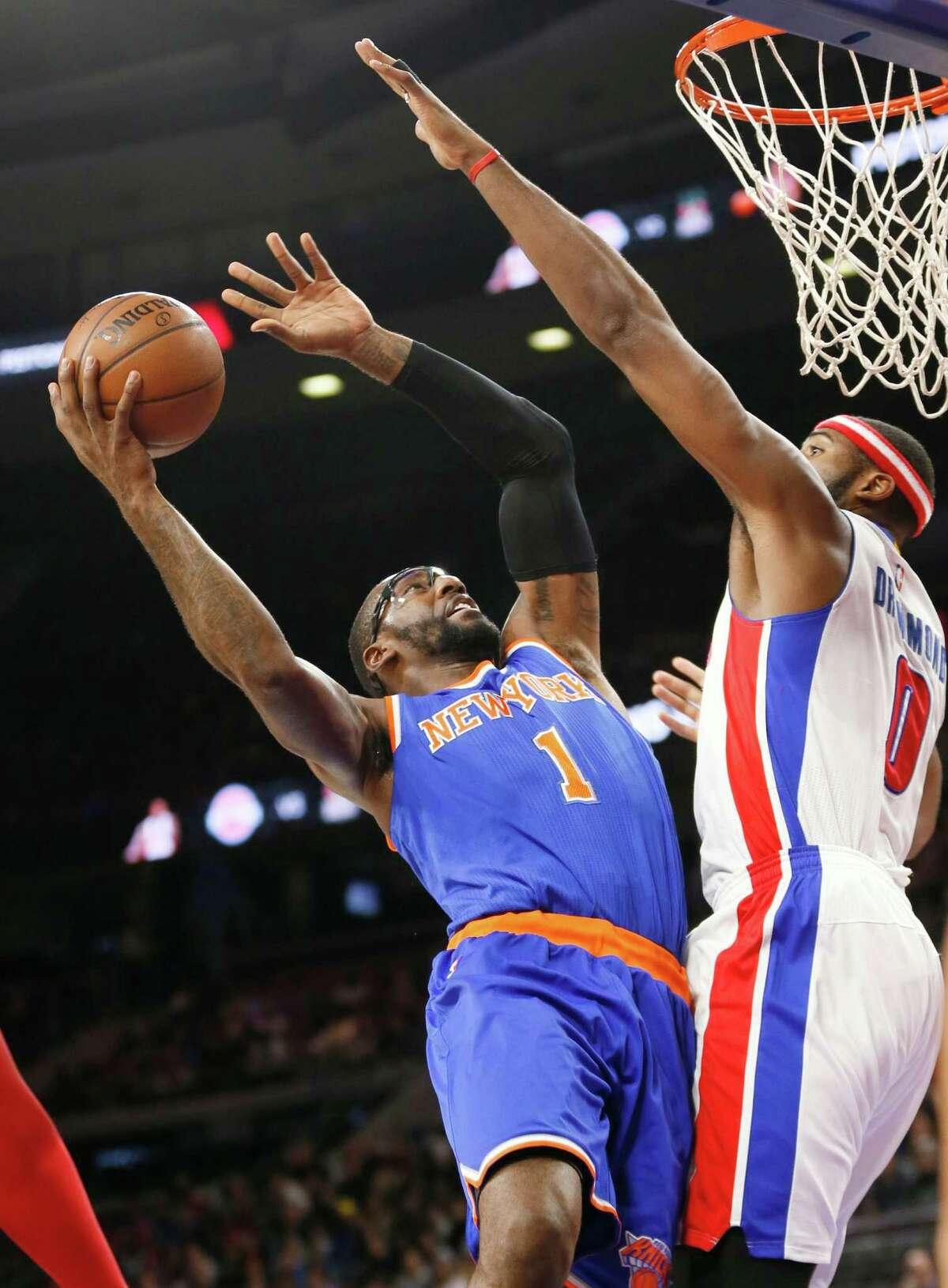 New York Knicks forward Amar'e Stoudemire (1) drives on Detroit Pistons center Andre Drummond (0) in the first half of an NBA basketball game in Auburn Hills, Mich., Wednesday, Nov. 5, 2014. (AP Photo/Paul Sancya) ORG XMIT: MIPS101