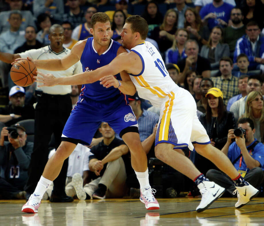 David Lee was back on the court Wednesday, pressuring Blake Griffin, but he reinjured his hamstring. Draymond Green's strong play creates the option of eventually having Lee ignite the second unit. Photo: Scott Strazzante / The Chronicle / ONLINE_YES
