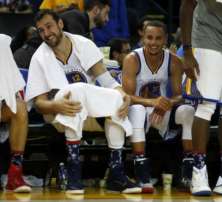 Golden State Warriors' Andrew Bogut and Stephen Curry enjoy themselves on bench late in 4th quarter of Warriors' 121-104 win over the Los Angeles Clippers during NBA game at Oracle Arena in Oakland, Calif., on Wednesday, November 5, 2014. Photo: Scott Strazzante, The Chronicle