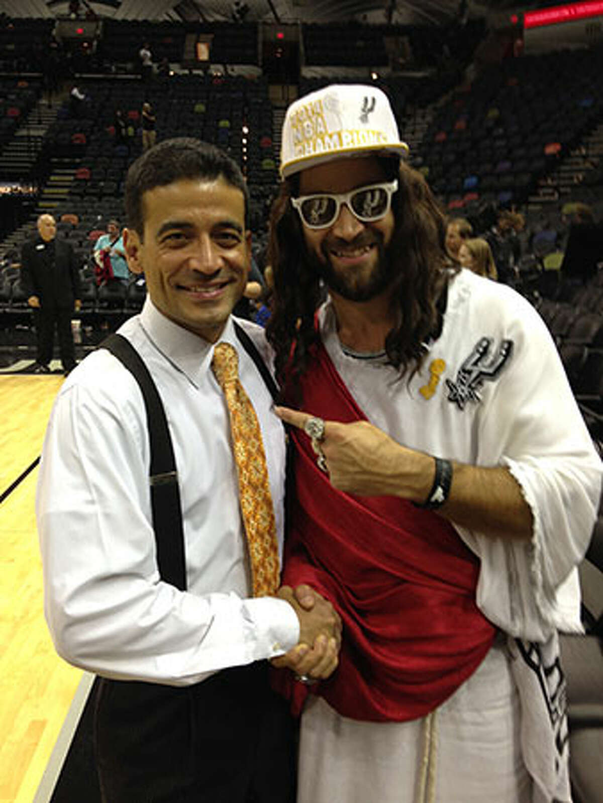 Spurs Jesus shakes hands with District Attorney-elect Nico LaHood at the AT&T Center on Wednesday, November 5, 2014.