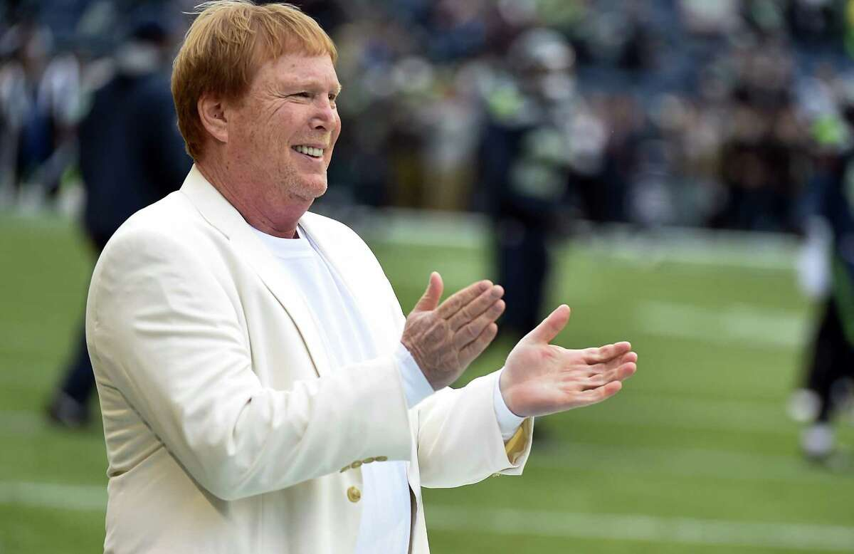 In this file photo, principal owner and managing general partner of the Oakland Raiders Mark Davis watches his team warm up before the game against the Seattle Seahawks. Davis has decied to keep the team in Oakland for another year.