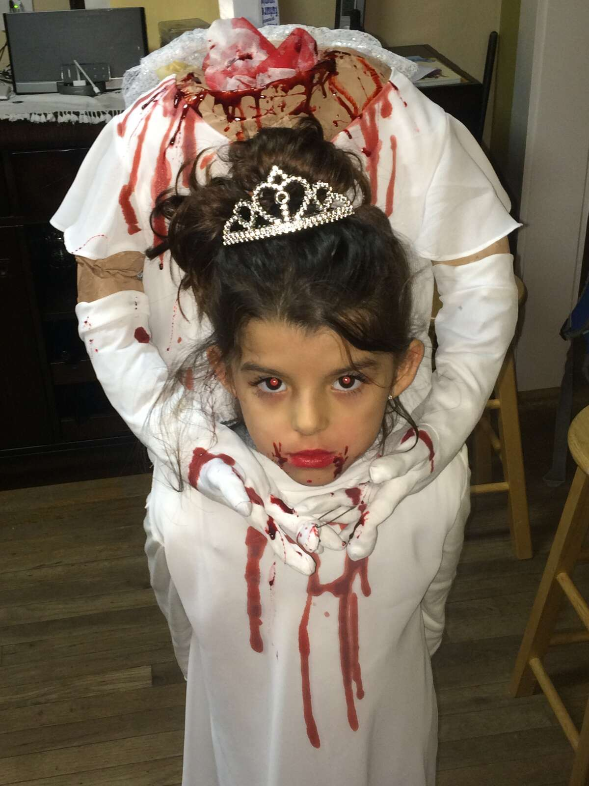 Congratulations to Rex Rehmeyer of Houston, who is the winner of our Halloween photo contest. Rex will receive a $500 gift card from Randall's for this adorable shot of a little girl holding her own head. Click through the slideshow to see more of the best Halloween photos Houston has to offer.