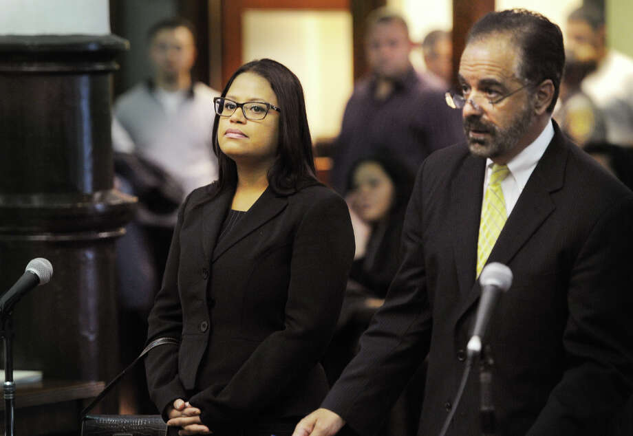 State Rep. Christina Ayala, D-Bridgeport, stands with her lawyer, Guy Soares, at Superior Court in Bridgeport, Conn. on Thursday, November 6, 2014. Ayala, facing multiple charges of voting fraud, had her case continued to December 9. Photo: Brian A. Pounds / Connecticut Post