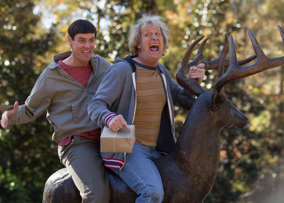 """Jim Carrey and Jeff Daniels in a scene from """"Dumb and Dumber To,"""" in which the dimwits go on the road. Photo: Hopper Stone / Associated Press / Universal Pictures"""