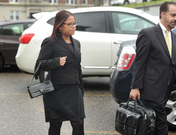 State Rep. Christina Ayala, D-Bridgeport, exits Superior Court with her lawyer, Guy Soares, in Bridgeport, Conn. on Thursday, November 6, 2014. Ayala, facing multiple charges of voting fraud, had her case continued to December 9. Photo: Brian A. Pounds / Connecticut Post