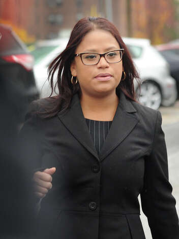 State Rep. Christina Ayala, D-Bridgeport, exits Superior Court in Bridgeport, Conn. on Thursday, November 6, 2014. Ayala, facing multiple charges of voting fraud, had her case continued to December 9. Photo: Brian A. Pounds / Connecticut Post